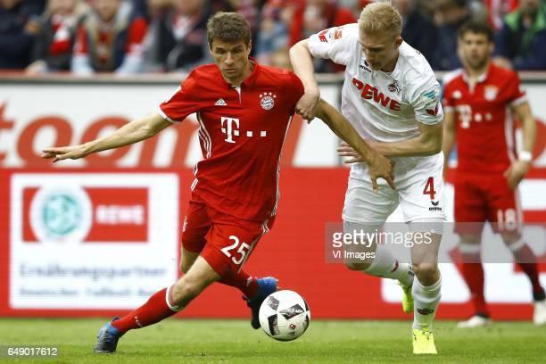 Thomas Muller of Bayern Munich Frederik Sorensen of 1FC Kolnduring the Bundesliga match between 1 FC Koln and Bayern Munich on March 04 2017 at the...