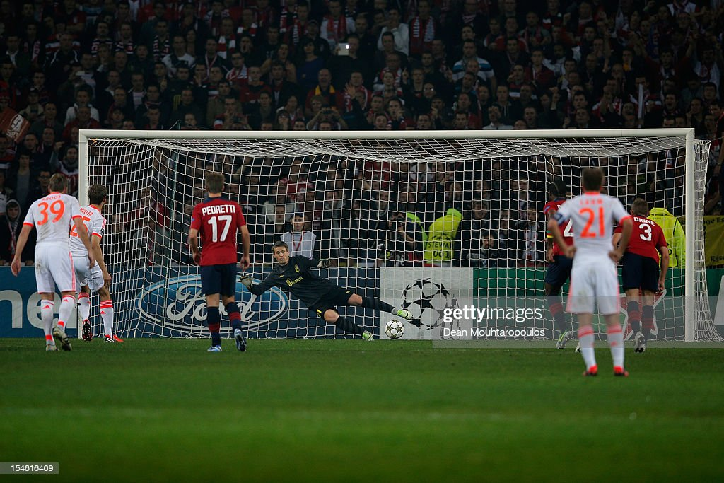 Thomas Muller (#25) of Bayern Munich takes and scores the first goal of the game from the penalty spot during the Group F UEFA Champions League match between OSC Lille and FC Bayern Muenchen at Grand Stade Lille Metropole on October 23, 2012 in Lille, France.