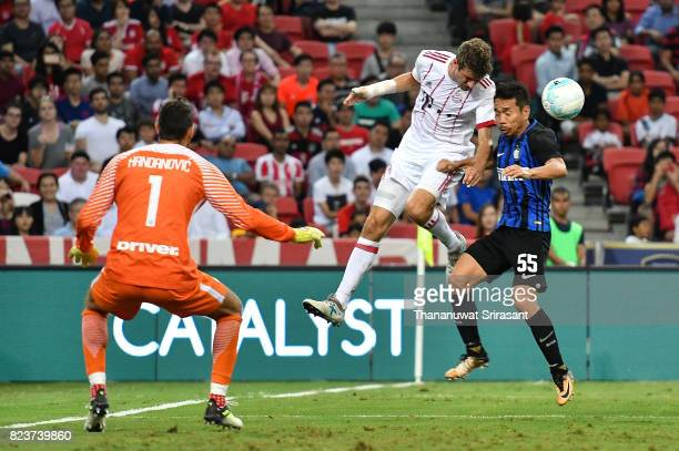 Thomas Muller of FC Bayern Muenchen and Yuto Nagatomo of FC Interernazionale competes for the ball during the International Champions Cup match...
