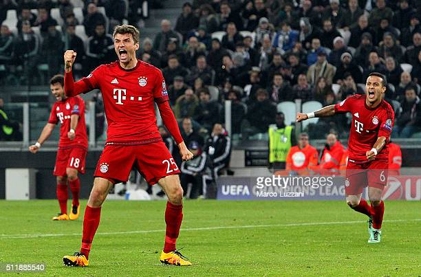 Thomas Muller of FC Bayern Muenchen celebrates after scoring the opening goal during the UEFA Champions League Round of 16 first leg match between...