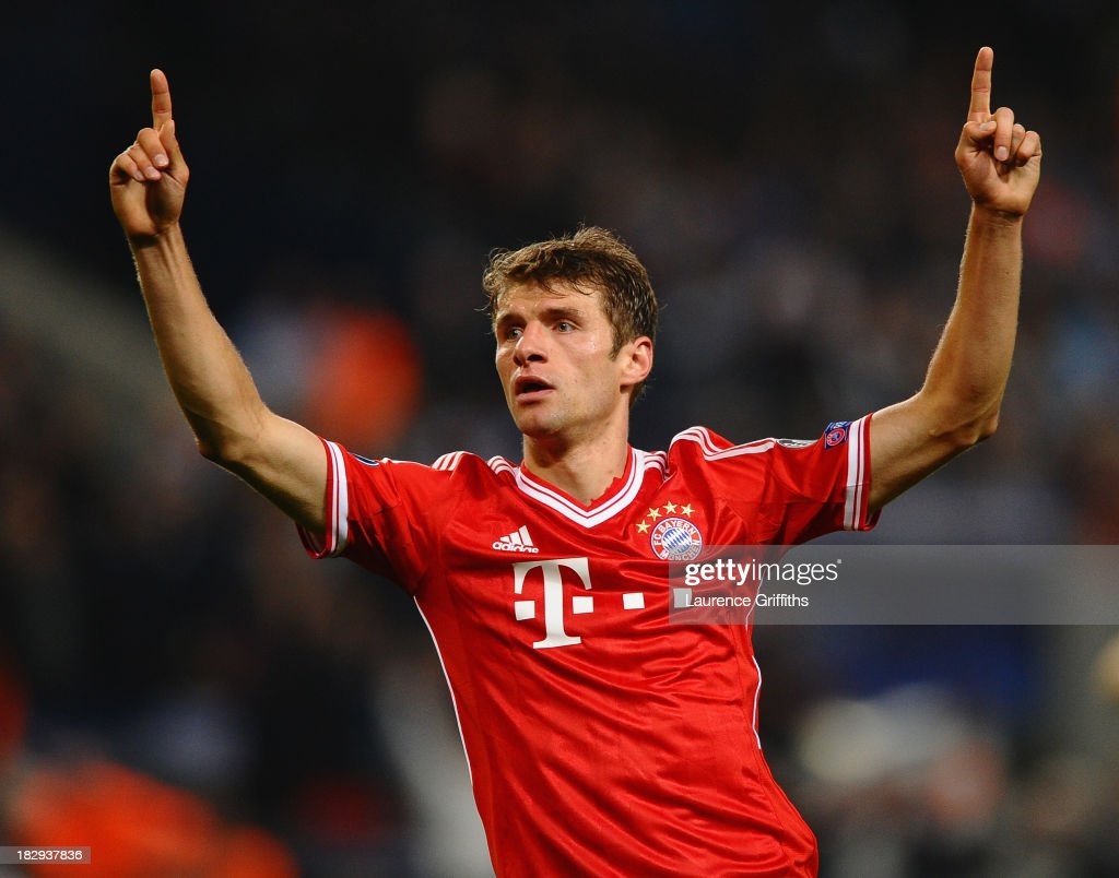 Thomas Muller of FC Bayern Muenchen celebrates scoring the second goal during the UEFA Champions League Group D match between Manchester City and FC Bayern Muenchen at Etihad Stadium on October 2, 2013 in Manchester, England.