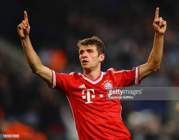 Thomas Muller of FC Bayern Muenchen celebrates scoring the second goal during the UEFA Champions League Group D match between Manchester City and FC...