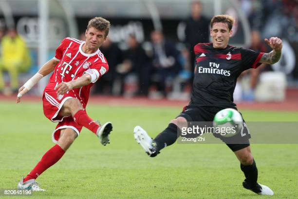Thomas Muller of FC Bayern Muenchen in action against Lucas Biglia of AC Milan during the 2017 International Champions Cup football match between AC...