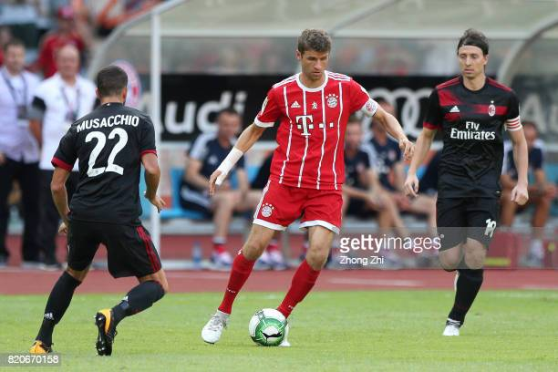 Thomas Muller of FC Bayern Muenchen in action against Mateo Musacchio and Riccardo Montolivo of AC Milan during the 2017 International Champions Cup...