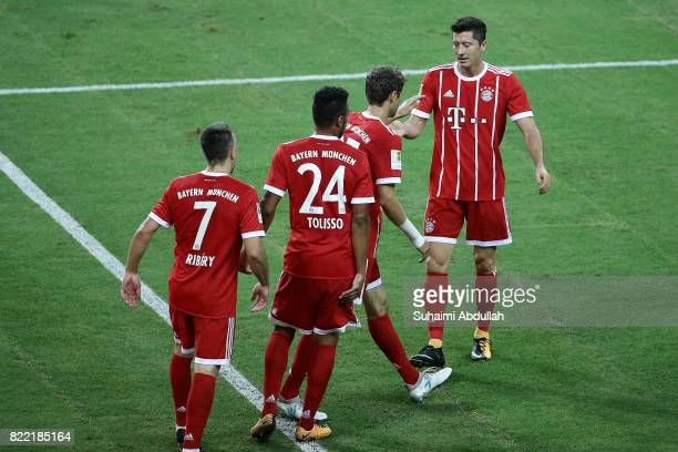 Thomas Muller of FC Bayern Munich celebrates with Robert Lewandowski after scoring a goal during the International Champions Cup match between...