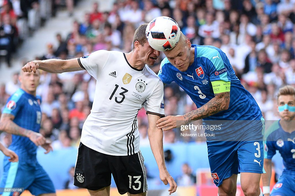 Thomas Muller of Germany and Martin Skrtel of Slovakia during the European Championship match Round of 16 between Germany and Slovakia at Stade Pierre-Mauroy on June 26, 2016 in Lille, France.