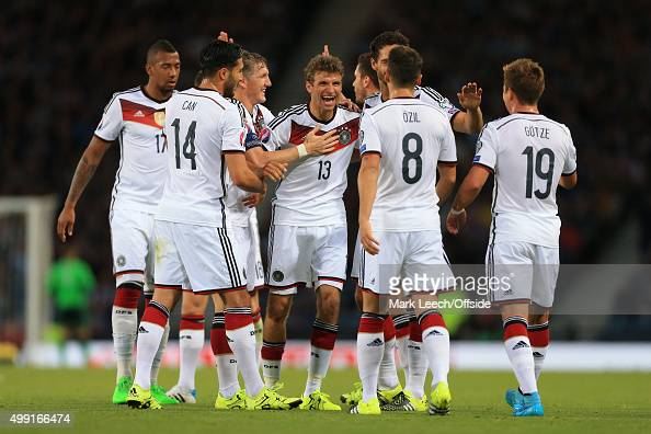 Thomas Muller of Germany celebrates with teammates after scoring their 1st goal during the UEFA EURO 2016 Qualifying Group D match between Scotland...