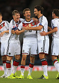 Thomas Muller of Germany celebrates with teammates Bastian Schweinsteiger and Mats Hummels after scoring their 1st goal during the UEFA EURO 2016...