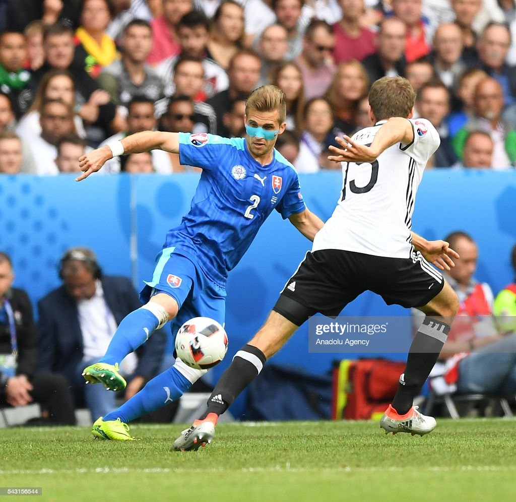 Thomas Muller (R) of Germany in action against Peter Pekarik (L) of Slovakia during the UEFA Euro 2016 round of 16 football match between Germany and Slovakia at Stade Pierre Mauroy in Lille, France on June 26, 2016.