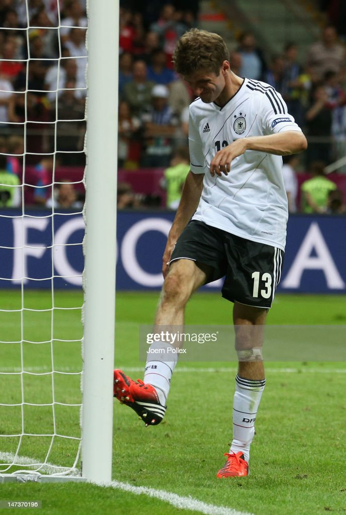 Thomas Muller of Germany kicks a goalpost as he shows his frustration after the UEFA EURO 2012 semi final match between Germany and Italy at National Stadium on June 28, 2012 in Warsaw, Poland.