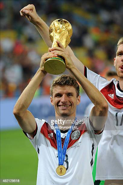 Thomas Muller of Germany lifts the trophy following the 2014 World Cup Final match between Germany and Argentina at Maracana Stadium on July 13 2014...