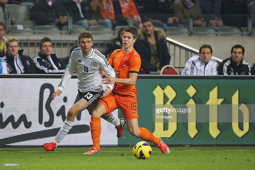 Thomas Muller of Germany, Marco van Ginkel of Holland during the Friendly match between Holland and Germany at the Amsterdam Arena on November 14, 2012 in Amsterdam, The Netherlands.