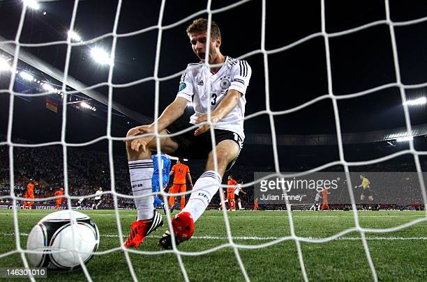 Thomas Muller of Germany picks the ball out of the net after Mario Gomez of Germany scored the opening goal during the UEFA EURO 2012 group B match...