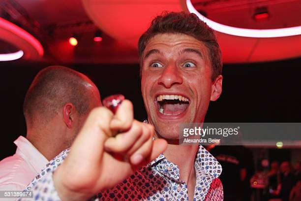 Thomas Muller smiles with his Championshop ring during the FC Bayern Muenchen Bundesliga Champions Dinner at the Postpalast on May 14 2016 in Munich...