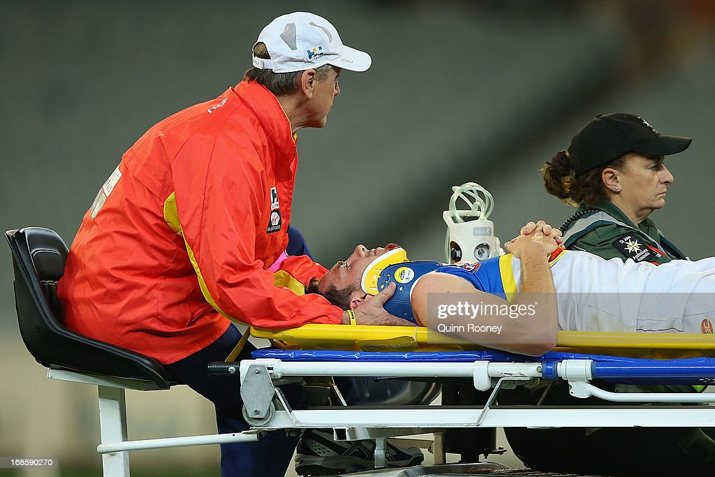 Thomas Murphy of the Suns is stretchered from the ground after colliding with Jack Viney of the Demons during the round seven AFL match between the Melbourne Demons and the Gold Coast Suns at Melbourne Cricket Ground on May 12, 2013 in Melbourne, Australia.