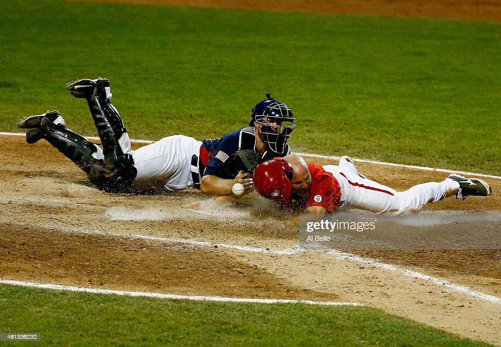 Thomas Murphy of the USA drops the ball as Peter Orr of Canada scores the winning run in the tenth inning making the score 76 during their Gold Medal...
