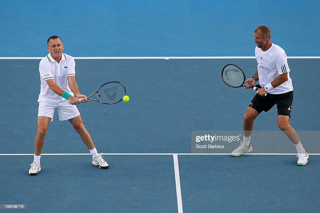 Thomas Muster of Austria and Mikael Pernfors of Sweden compete in their legends doubles match against Wayne Ferreira of South Africa and Yevgeny Kafelnikov of Russia during day seven of the 2011 Australian Open at Melbourne Park on January 23, 2011 in Melbourne, Australia.