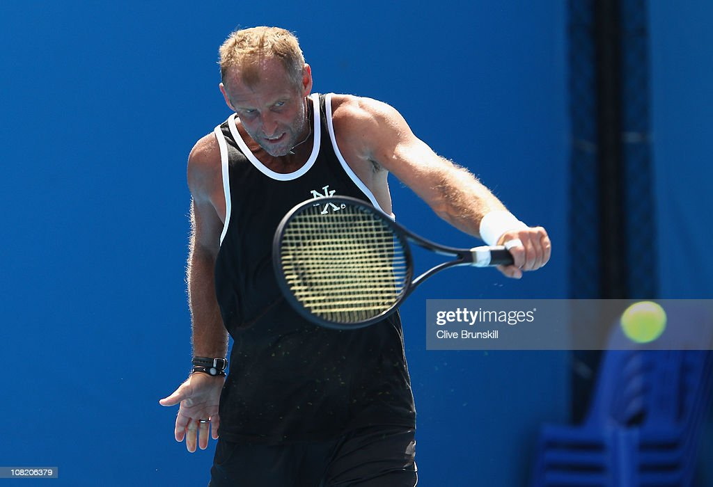 Thomas Muster of Austria plays a backhand on the practise courts during day five of the 2011 Australian Open at Melbourne Park on January 21 2011 in...