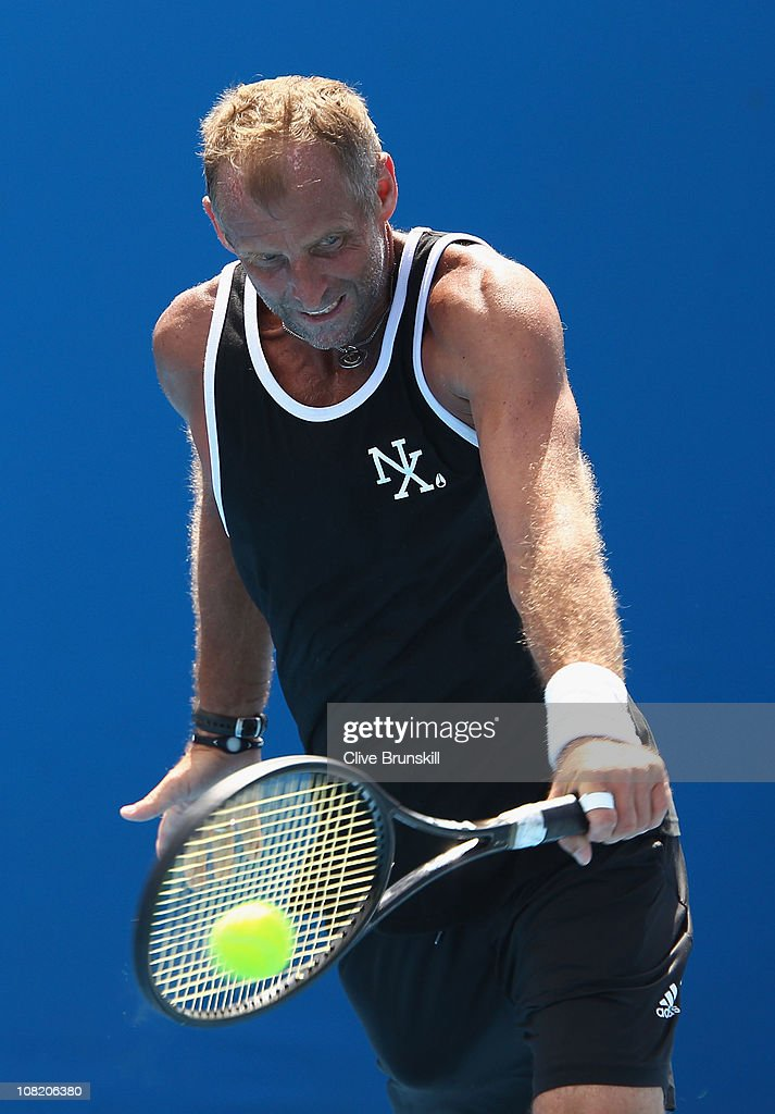 <a gi-track='captionPersonalityLinkClicked' href=/galleries/search?phrase=Thomas+Muster&family=editorial&specificpeople=211582 ng-click='$event.stopPropagation()'>Thomas Muster</a> of Austria plays a backhand on the practise courts during day five of the 2011 Australian Open at Melbourne Park on January 21, 2011 in Melbourne, Australia.