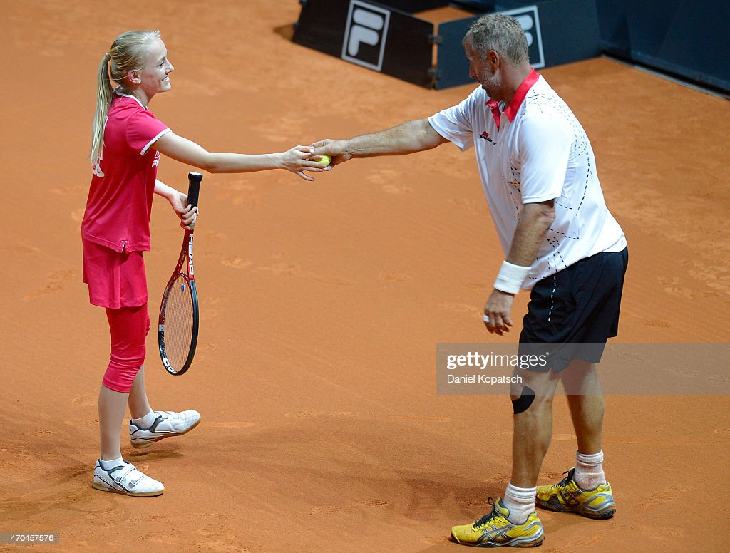 <a gi-track='captionPersonalityLinkClicked' href=/galleries/search?phrase=Thomas+Muster&family=editorial&specificpeople=211582 ng-click='$event.stopPropagation()'>Thomas Muster</a> (R) of Austria reacts during his Berenberg Classic match against Andre Agassi of the USA on day one of the Porsche Tennis Grand Prix at Porsche-Arena on April 20, 2015 in Stuttgart, Germany.