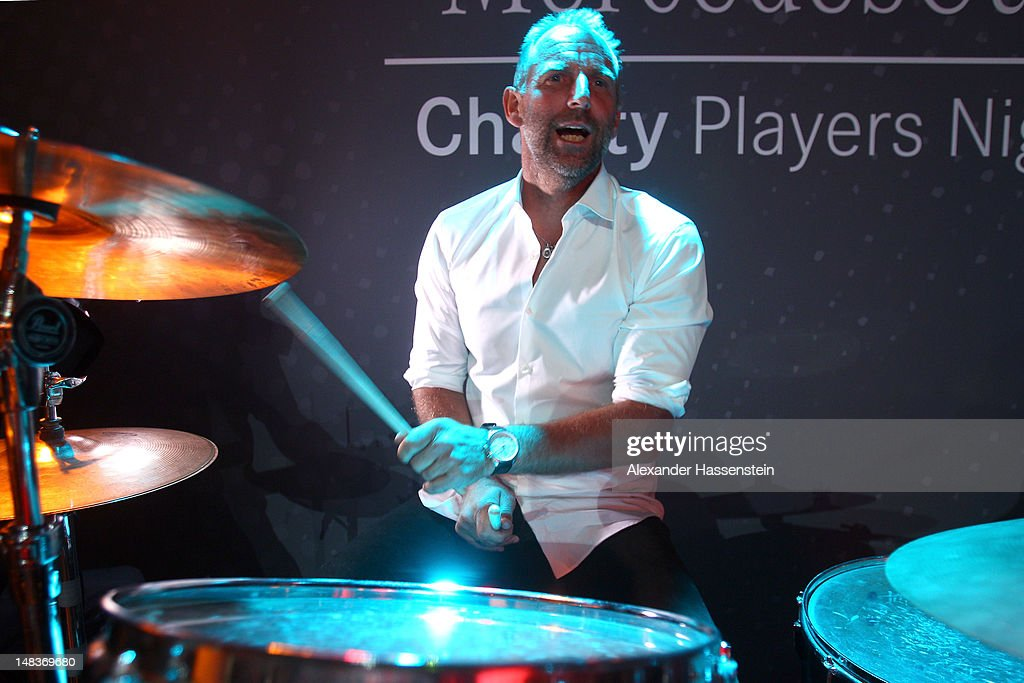 <a gi-track='captionPersonalityLinkClicked' href=/galleries/search?phrase=Thomas+Muster&family=editorial&specificpeople=211582 ng-click='$event.stopPropagation()'>Thomas Muster</a> plays drums during the Mercedes Cup Charity Players Night at Breuningers during the Mercedes Cup 2012 at the TC Weissenhof on July 14, 2012 in Stuttgart, Germany.