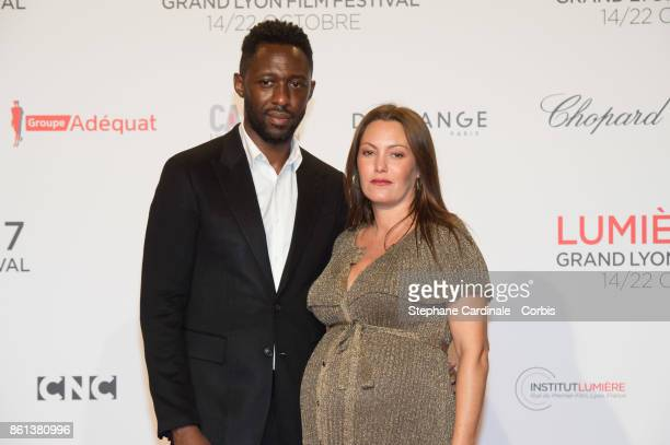 Thomas N'Gijol and Karole Rocher attend the Opening Ceremony of the 9th Film Festival Lumiere on October 14 2017 in Lyon France
