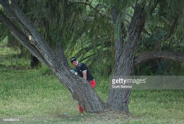 Thomas Norret of Denmark plays out of the woods on the 9th hole during day two of the Perth International at Lake Karrinyup Country Club on October...