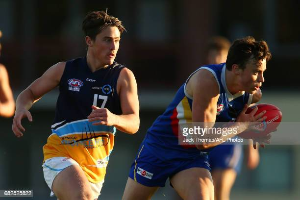 Thomas North of the Ranges runs with the ball during the round seven TAC Cup match between the Eastern Ranges and the Bendigo Pioneers at Box Hill...