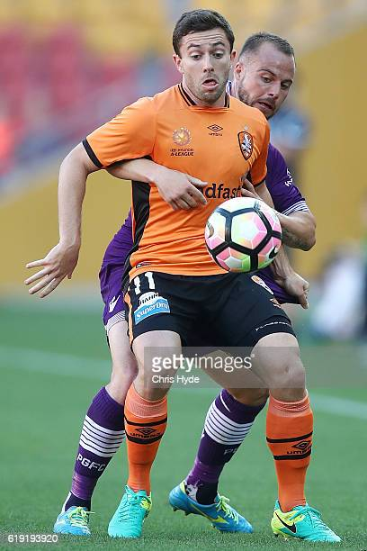 Thomas Oar of the Roar and Marc Warren of the Glory compete for the ball during the round four ALeague match between the Brisbane Roar and Perth...