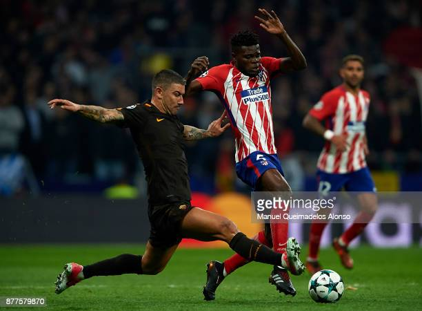 Thomas of Atletico de Madrid competes for the ball with Aleksandar Kolarov of Roma during the UEFA Champions League group C match between Atletico...