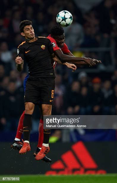 Thomas of Atletico de Madrid competes for the ball with Perotti of Roma during the UEFA Champions League group C match between Atletico Madrid and AS...
