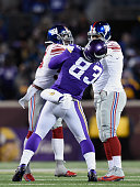 T Thomas of the New York Giants throws a punch at MyCole Pruitt of the Minnesota Vikings between plays as Barry Cofield of the New York Giants looks...