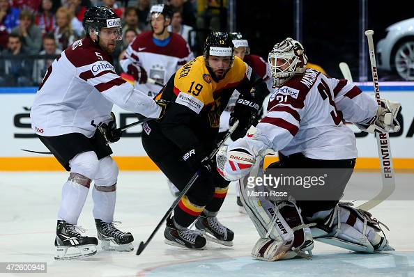 Thomas Oppenheimer of Germany fails to score over Edgars Masalskis goaltender of Latvia during the IIHF World Championship group A match between...