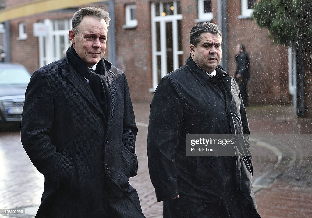 Thomas Oppermann (L) and Sigmar Gabriel, Chairman of the German Social Democrats (SPD) arrive at a memorial service for former German Defence Minister Peter Struck on January 3, 2013 in Uelzen, Germany. Struck was a leading member of the German Social Democrats (SPD) and died in December following a heart attack.
