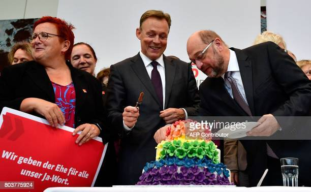 Thomas Oppermann parliamentary group leader of the social democratic SPD party and SPD leader and candidate for chancellor Martin Schulz cut a...