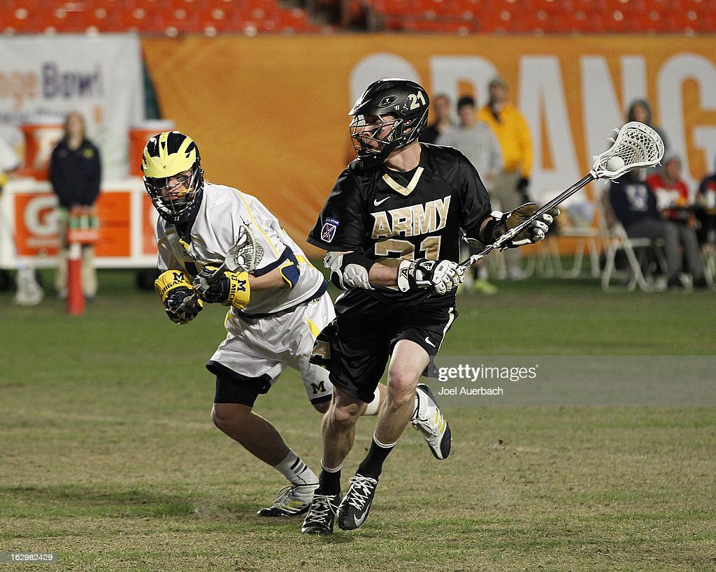Thomas Orr #43 of the Michigan Wolverines defends against John Glesener #21 of the Army Black Knights during the 2013 Orange Bowl Lacrosse Classic on March 2, 2013 at SunLife Stadium in Miami Gardens, Florida. Army defeated Michigan 12-1.