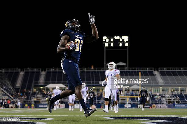 Thomas Owens of the FIU Panthers gestures after scoring a touchdown during the game against the Louisiana Tech Bulldogs at FIU Stadium on October 22...