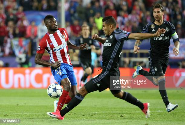 Thomas Partey of Atletico Madrid and Casemiro of Real Madrid during the UEFA Champions League Semi Final second leg match between Club Atletico de...