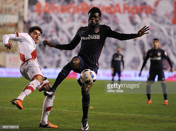 Thomas Partey of Club Atletico de Madrid controls the ball while being challenged by Jozabed Snchez Ruiz of Rayo Vallecano de Madrid during the Copa...