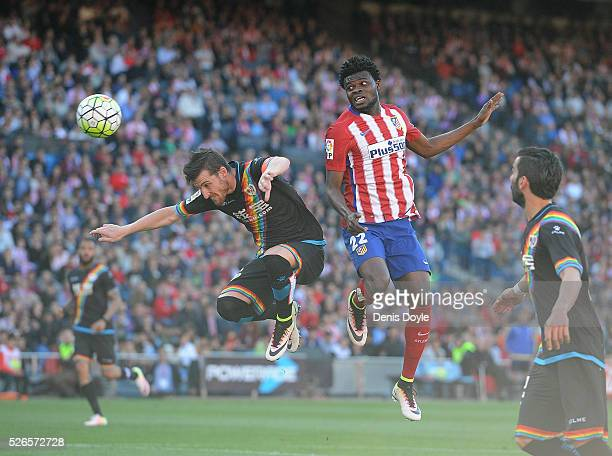 Thomas Partey of Club Atletico de Madrid heads the ball past Robrto Roman Triguero 'Tito' of Rayo Vallecano during the La Liga match between Club...