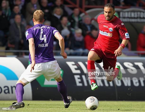 Thomas Paulus of Aue challenges Mahir Saglik of Paderborn during the 2nd Liga match between FC Erzgebirge Aue and SC Paderborn 07 at...