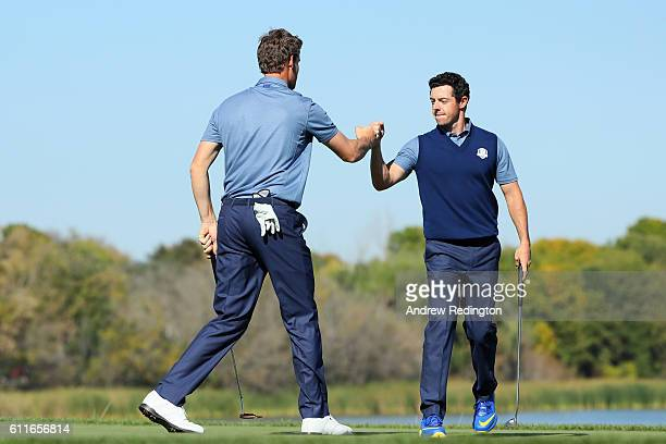 Thomas Pieters and Rory McIlroy of Europe react on the seventh green during afternoon fourball matches of the 2016 Ryder Cup at Hazeltine National...
