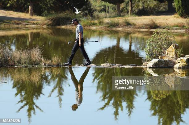 Thomas Pieters of Belgium crosses to the 17th tee during day four of the Portugal Masters at Dom Pedro Victoria Golf Club on September 24 2017 in...