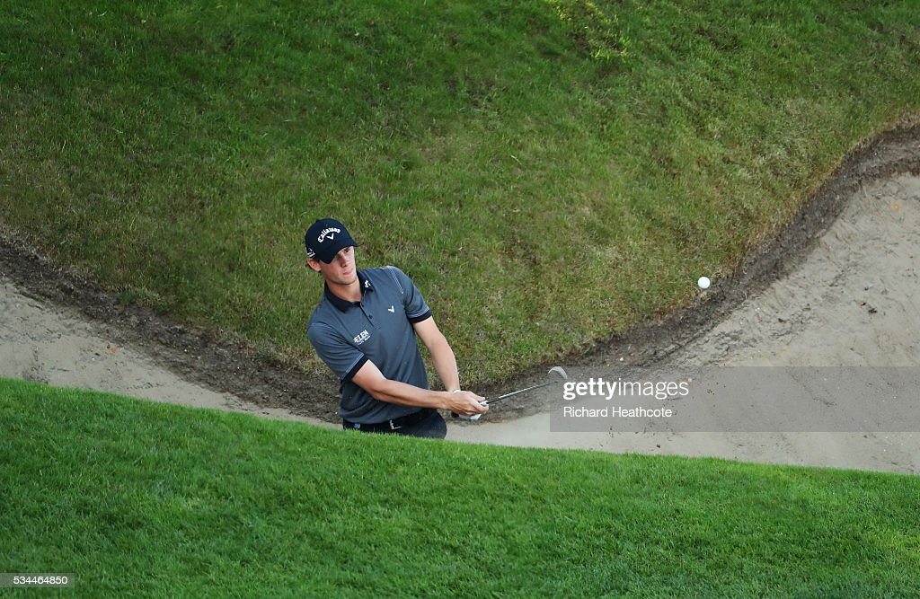 <a gi-track='captionPersonalityLinkClicked' href=/galleries/search?phrase=Thomas+Pieters&family=editorial&specificpeople=7157992 ng-click='$event.stopPropagation()'>Thomas Pieters</a> of Belgium hits from a bunker on the 18th hole during day one of the BMW PGA Championship at Wentworth on May 26, 2016 in Virginia Water, England.