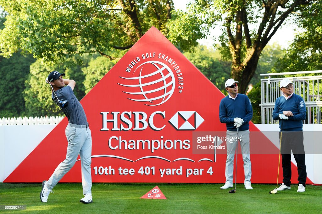 Thomas Pieters of Belgium plays a shot as Chairman Richard Cheung, Sheshan International Golf Club, looks on during the pro-am prior to the WGC - HSBC Champions at Sheshan International Golf Club on October 25, 2017 in Shanghai, China.