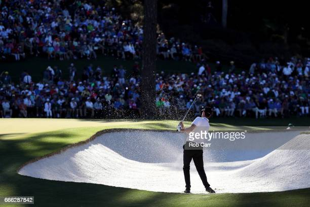 Thomas Pieters of Belgium plays a shot from a bunker on the 15th hole during the third round of the 2017 Masters Tournament at Augusta National Golf...