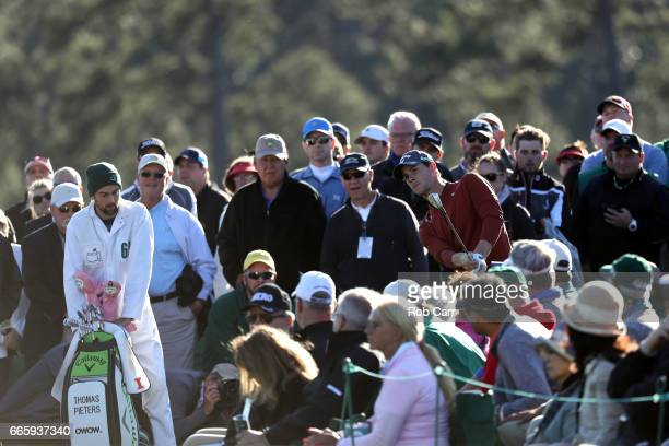 Thomas Pieters of Belgium plays his third shot surrounded by a gallery of patrons on the 18th green during the second round of the 2017 Masters...