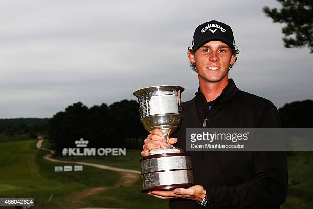 Thomas Pieters of Belgium poses with the trophy after winning the KLM Open held at Kennemer G CC on September 13 2015 in Zandvoort Netherlands