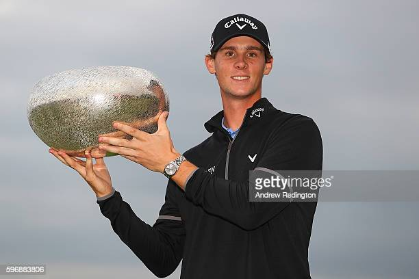Thomas Pieters of Belgium poses with the trophy following his victory during the final round of Made in Denmark at Himmerland Golf Spa Resort on...