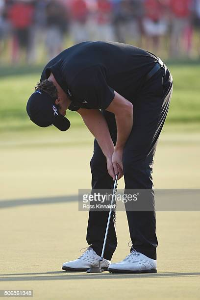 Thomas Pieters of Belgium reacts after missing his eagle attempt on the 18th green during round four of the Abu Dhabi HSBC Golf Championship at the...